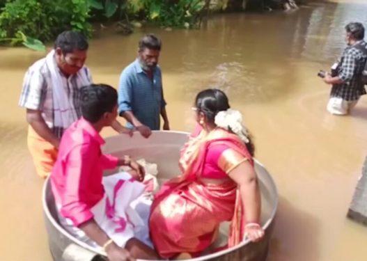 Nuk donin të shtyjnë dasmën/ Çifti shkon në ceremoninë e martesës duke lundruar në një tenxhere pas shirave të rrëmbyeshëm